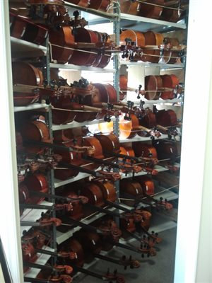 Cello Shopping at Robert Cauer Violins, Los Angeles California.